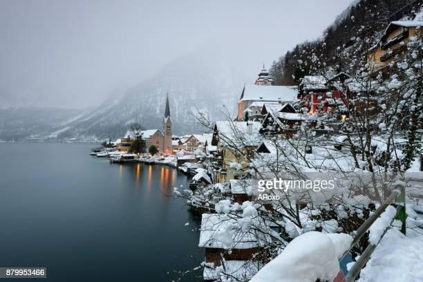 hallstatt looks like christmas village in a fairy tale - hallstatt stock pictures, royalty-free photos & images