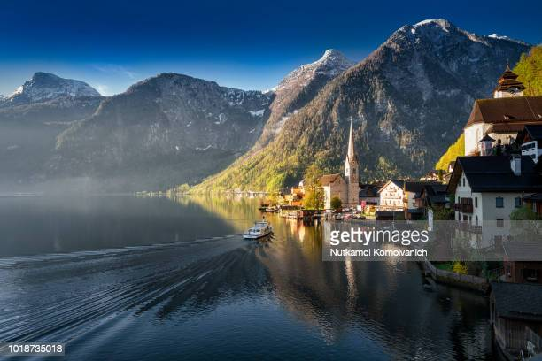 hallstatt pier beautiful famous world heritage place - austria stock pictures, royalty-free photos & images