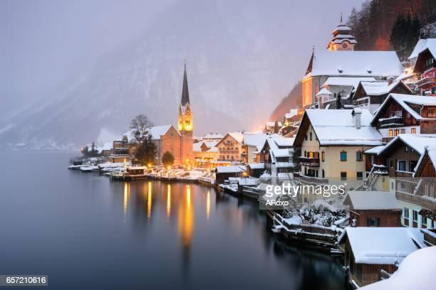 Hallstatt Unesco typical village with snow at sunset.