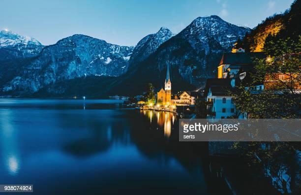 hallstatt village and hallstatter see lake at night in austria - hallstatt stock pictures, royalty-free photos & images