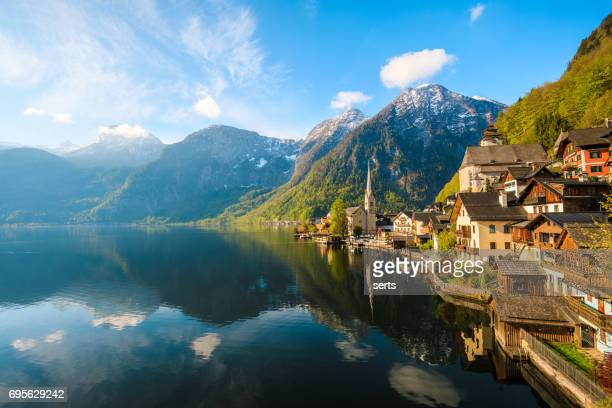 hallstatt village and hallstatter see lake in austria - european alps stock photos and pictures