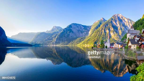 hallstatt village and hallstatter see lake in austria - austria stock photos and pictures