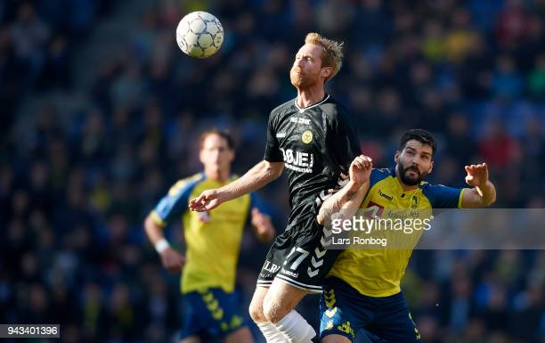 Hallur Hansson of AC Horsens and Anthony Jung of Brondby IF compete for the ball during the Danish Alka Superliga match between Brondby IF and AC...