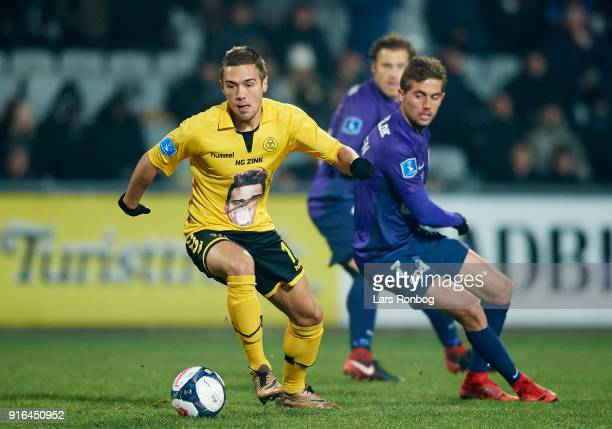 Hallur Hansson of AC Horsens and Jakob Poulsen of FC Midtjylland compete for the ball during the Danish Alka Superliga match between AC Horsens and...