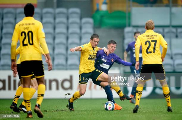 Hallur Hansson of AC Horsens and Mikkel Duelund of FC Midtjylland compete for the ball during the Danish Alka Superliga match between AC Horsens and...