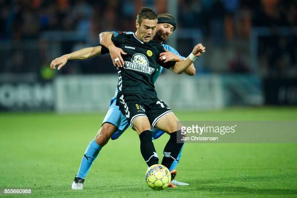 Hallur Hansson of AC Horsens and Perry Kitchen of Randers FC compete for the ball during the Danish Alka Superliga match between Randers FC and AC...