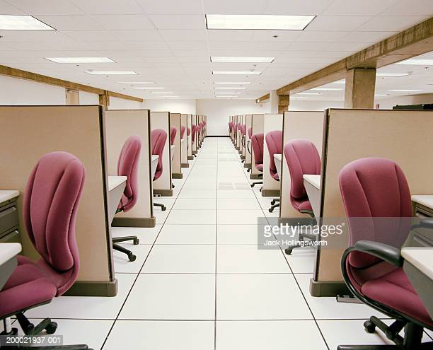 Hallway between rows of empty cubicles