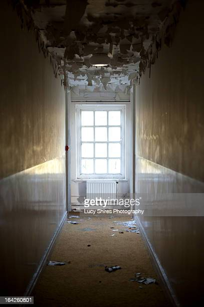 hallway in abandoned building - lucy shires stock pictures, royalty-free photos & images