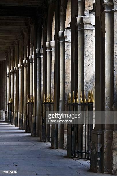 hallway with arches and ornamental fences, jardin du palais royal, paris, france - jardin du palais royal stock pictures, royalty-free photos & images
