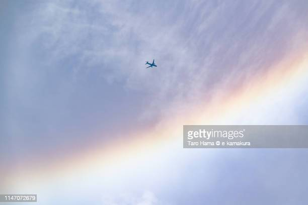 halo and the flying airplane in the sky in japan - rainbow sky stock pictures, royalty-free photos & images