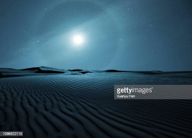 halo around full moon above the desert - sand dune stock pictures, royalty-free photos & images