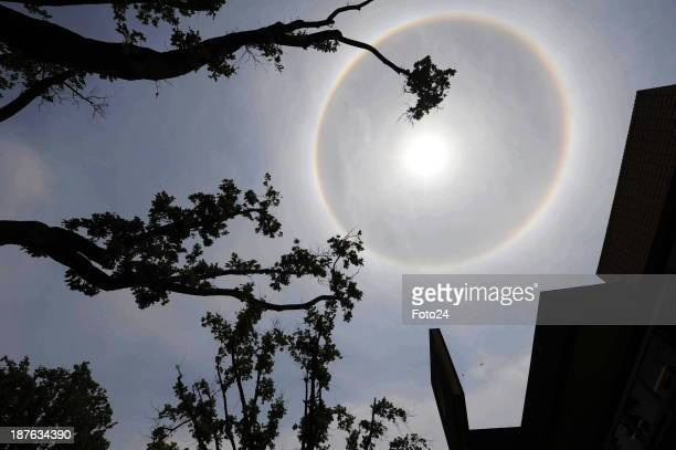 A halo is seen around the sun on November 6 2013 in Potchefstroom South Africa Claire Flanegan an astronomer at the Johannesburg Planetarium said the...