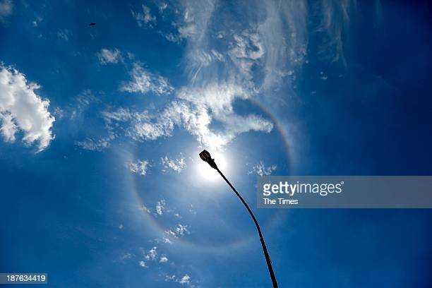 A halo is seen around the sun on November 6 2013 in Soweto South Africa Claire Flanegan an astronomer at the Johannesburg Planetarium said the ring...