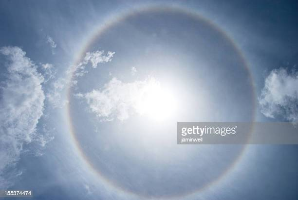 halo nimbus or gloriole around bright sunbeam and sky