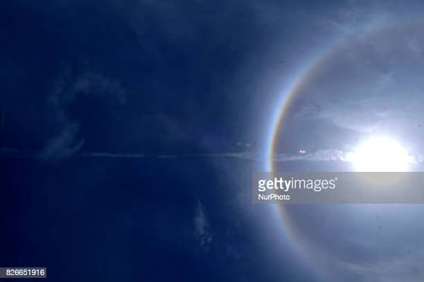A 22° halo surrounded the sun as it shined on Kathmandu Nepal on Saturday August 5 2017 The phenomenon appearing as sunlight refracts in millions of...