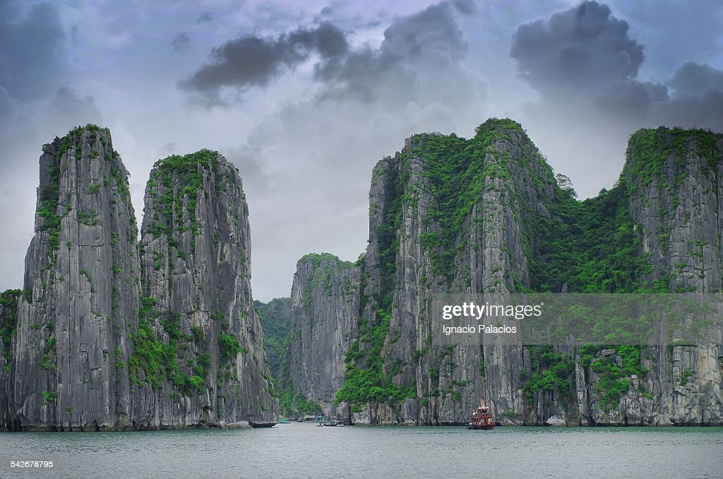 Halong bay limestone cliffs at sunset : Stock Photo