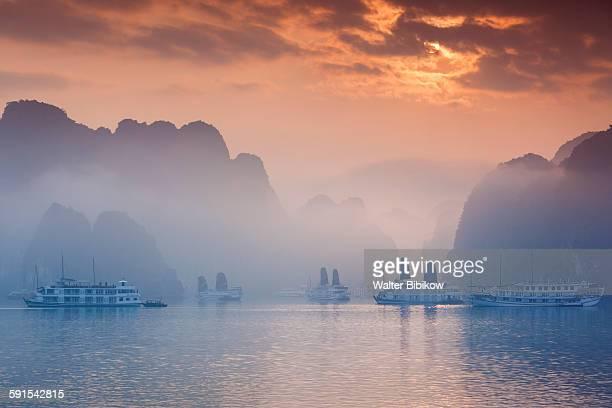 Halong Bay, tourist boats, sunrise