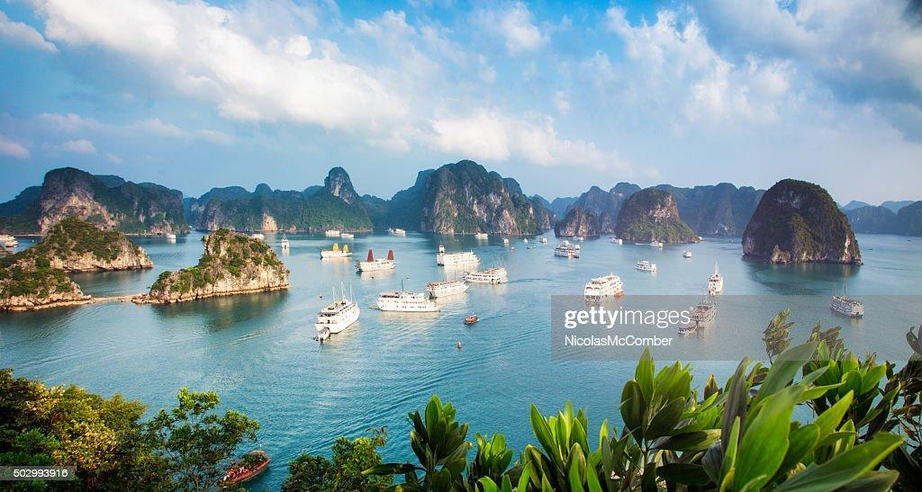 Halong Bay Vietnam panorama at sunset with anchored ships : Stock Photo