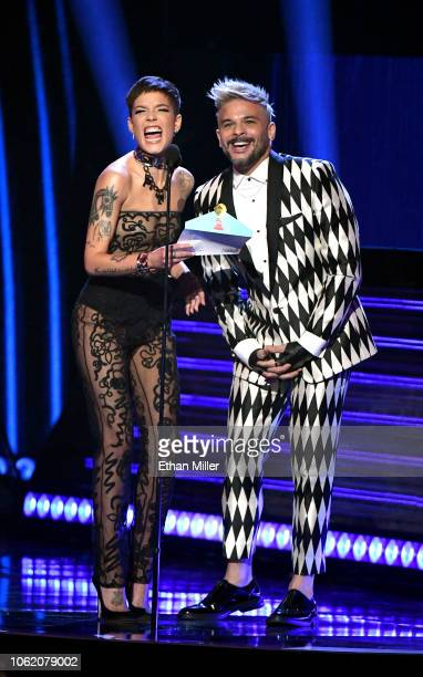 Halsey and Pedro Capo speak onstage during the 19th annual Latin GRAMMY Awards at MGM Grand Garden Arena on November 15 2018 in Las Vegas Nevada
