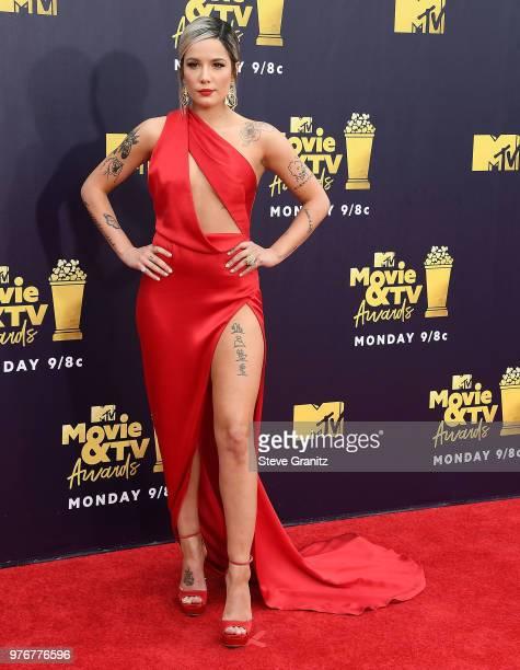Halsey arrives at the 2018 MTV Movie And TV Awards at Barker Hangar on June 16 2018 in Santa Monica California