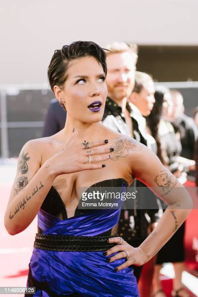 Halsey arrives at the 2019 Billboard Music Awards at MGM Grand Garden Arena on May 01 2019 in Las Vegas Nevada
