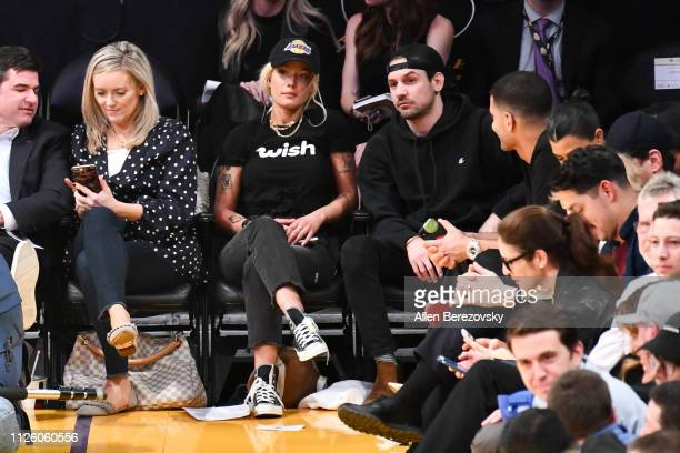 Halsey attends a basketball game between the Los Angeles Lakers and the Philadelphia 76ers at Staples Center on January 29 2019 in Los Angeles...