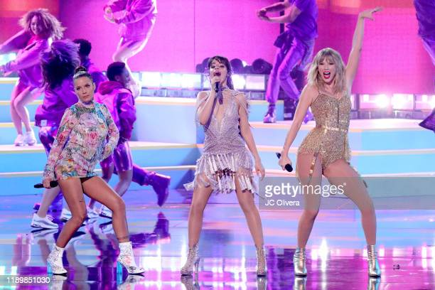 Halsey Camila Cabello and Taylor Swift perform onstage during the 2019 American Music Awards at Microsoft Theater on November 24 2019 in Los Angeles...
