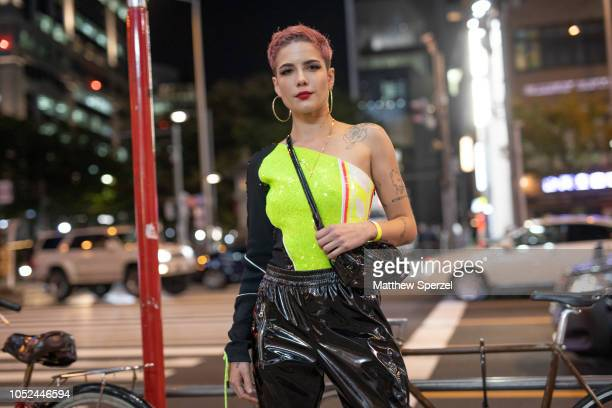 Halsey is seen wearing neon top with vinyl black pants during the Amazon Fashion Week TOKYO 2019 S/S on October 18 2018 in Tokyo Japan