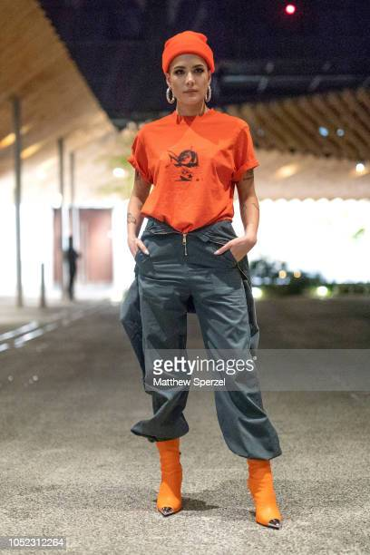 Halsey is seen wearing orange tshirt beanie and olive jumpsuit with orange boots during the Amazon Fashion Week TOKYO 2019 S/S on October 16 2018 in...