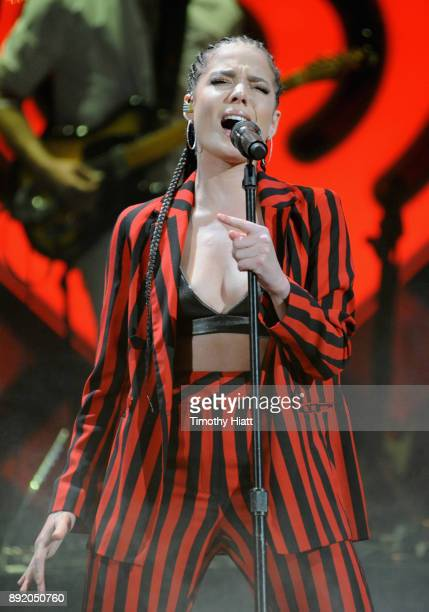 Halsey performs onstage during 1035 KISS FM's Jingle Ball 2017 at Allstate Arena on December 13 2017 in Rosemont Illinois