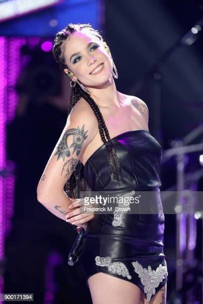 Halsey performs onstage during Dick Clark's New Year's Rockin' Eve with Ryan Seacrest 2018 on December 31 2017 in Los Angeles California