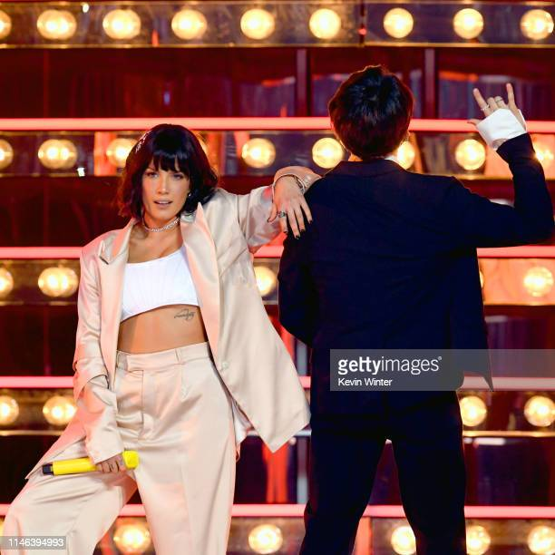 Halsey performs with BTS onstage during the 2019 Billboard Music Awards at MGM Grand Garden Arena on May 01 2019 in Las Vegas Nevada