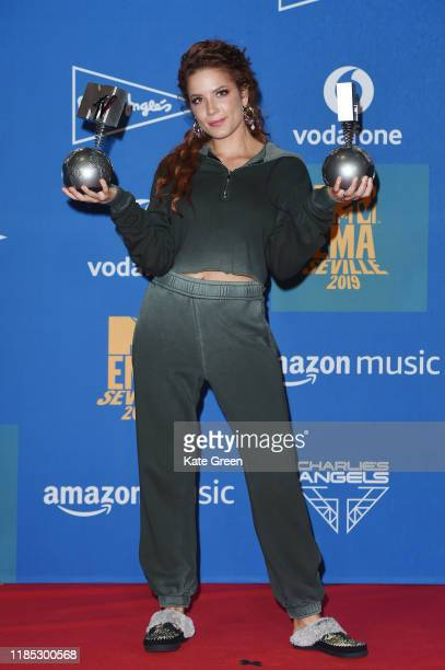 Halsey poses with the Best Pop and Best Look awards in the winners room during the MTV EMAs 2019 at FIBES Conference and Exhibition Centre on...
