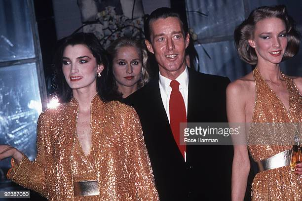 Halston and the Halstonettes at a perfume launch held at Saks 5th Ave., New York, ca.1980s.