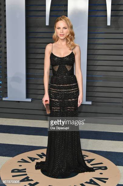 Halston Sage attends the 2018 Vanity Fair Oscar Party hosted by Radhika Jones at Wallis Annenberg Center for the Performing Arts on March 4 2018 in...