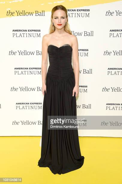 Halston Sage poses on the Yellow carpet at the Yellow Ball hosted by American Express and Pharrell Williams at the Brooklyn Museum on September 10...