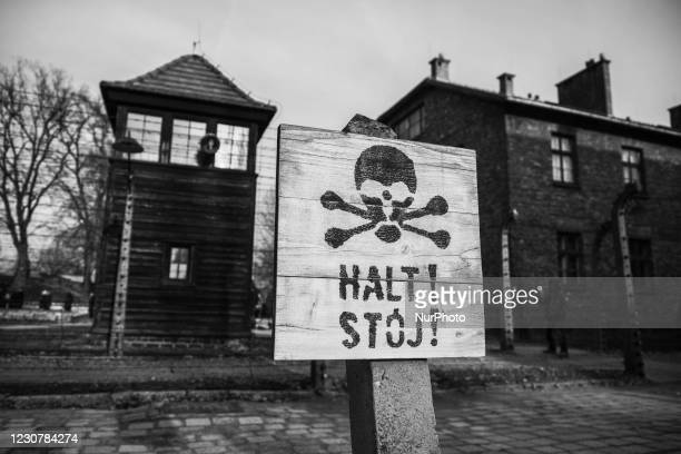 Image was converted to black and white) Halt! sign at the former Nazi-German Auschwitz I concentration and extermination camp in Oswiecim, Poland on...