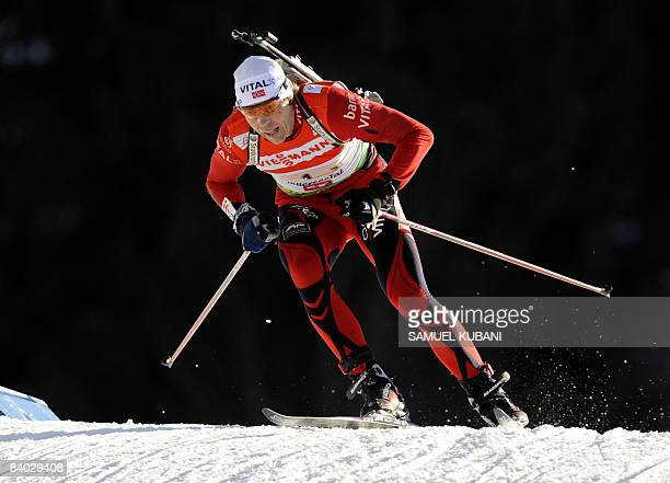 Halvard Hanevold from Norway competes during the men's biathlon World Cup 4 x 7,5 km relay competition in Hochfilzen on December 14, 2008. AFP PHOTO...