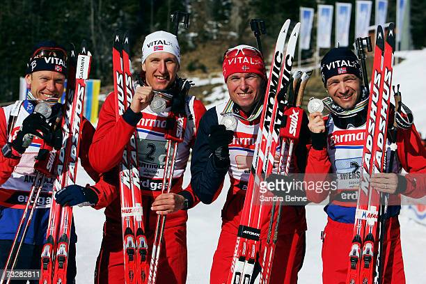 Halvard Hanevold Lars Berger Frode Andresen and Ole Einar Bjoerndalen of Norway celebrate winning the silver medal of the Men's 4 x 75 Relay in the...