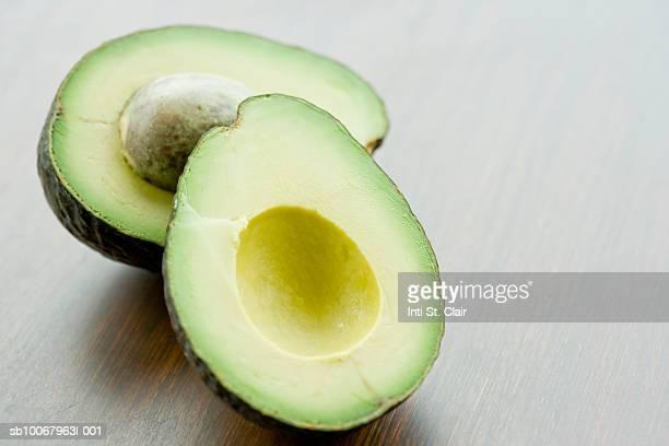 Halved avocado on tabletop, close up