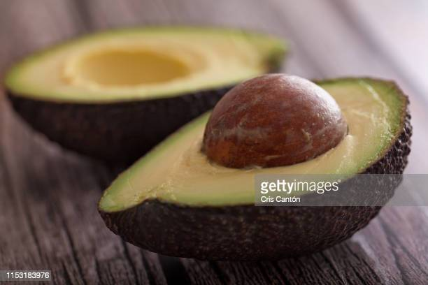 halved avocado - cris cantón photography stock pictures, royalty-free photos & images