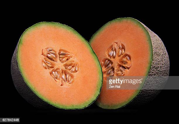 Halved Cantaloupe, Cantalope, Muskmelon, Cucumis Melo, Mushmelon, Rockmelon close-up on black background