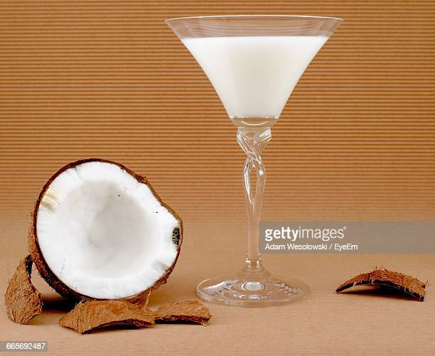 Halved Coconut With Glass Of Coconut Milk