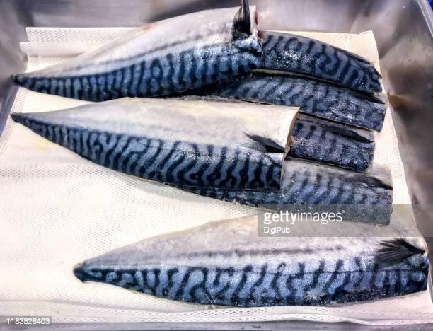 halved frozen mackerel imported from china at market in yokohama - fish scale pattern ストックフォトと画像