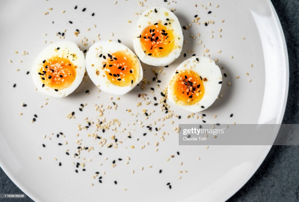 Halved hard-boiled eggs on a plate : Stock Photo
