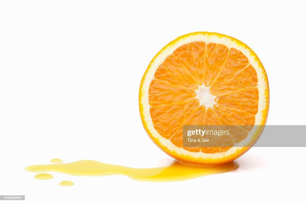 Halved orange with juice : Stock Photo