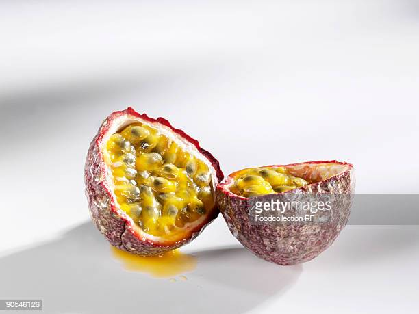 Halved passion fruit on white background, close up