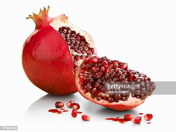 halved pomegranate - tropical fruit stock pictures, royalty-free photos & images