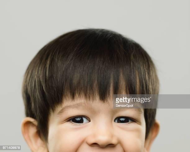 Halved portrait of happy real kid