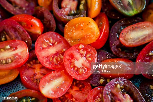 halved tomatoes - tomato stock pictures, royalty-free photos & images